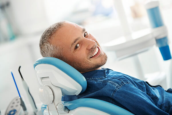 A mature man smiling at the dentist