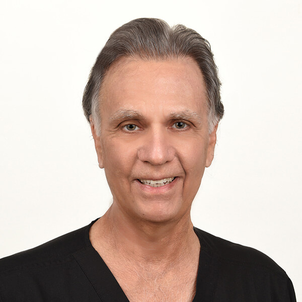 Dr. Arthur Kapit smiling in his scrubs